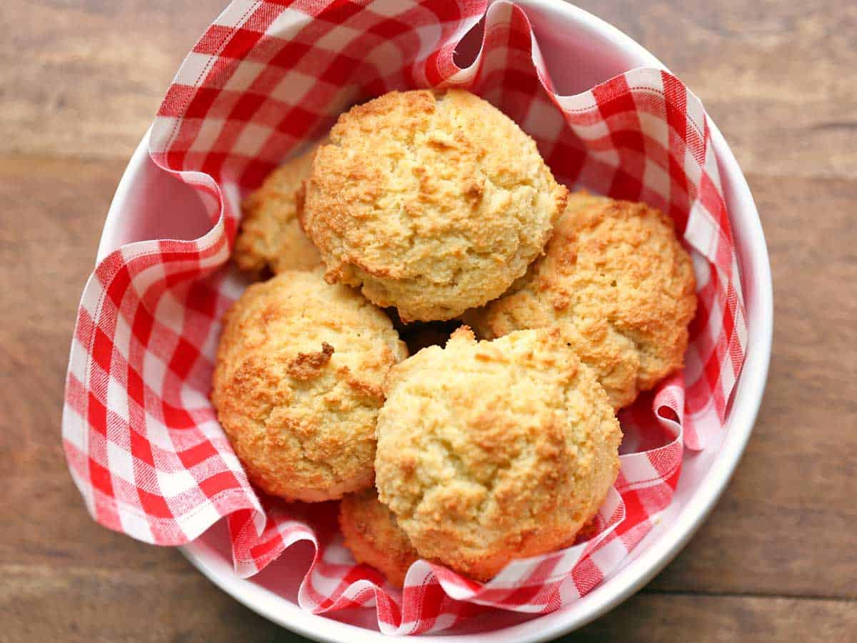 Almond flour biscuits served in a bowl with a napkin.