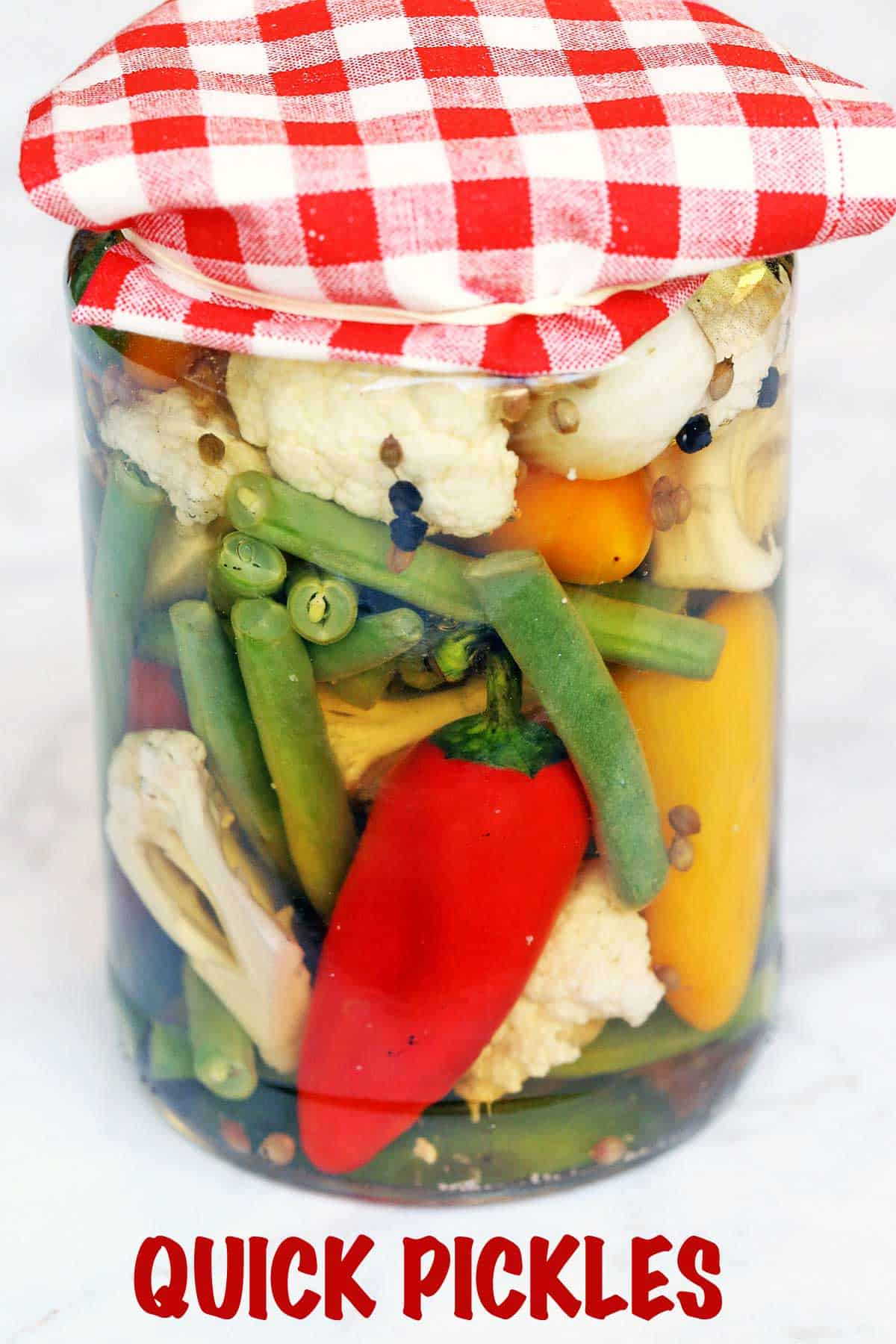 Homemade quick pickles served in a glass jar.