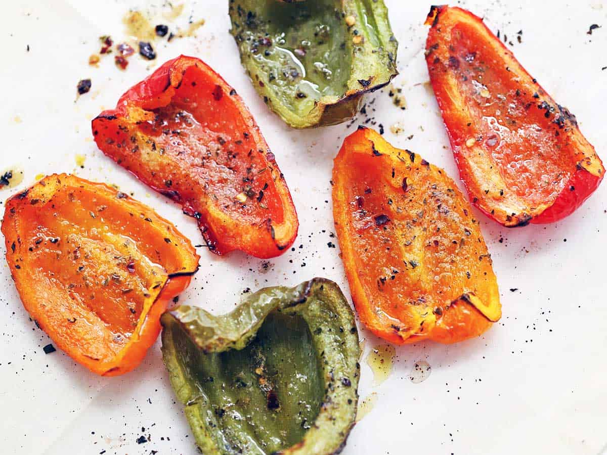 Roasted peppers served on a white plate.