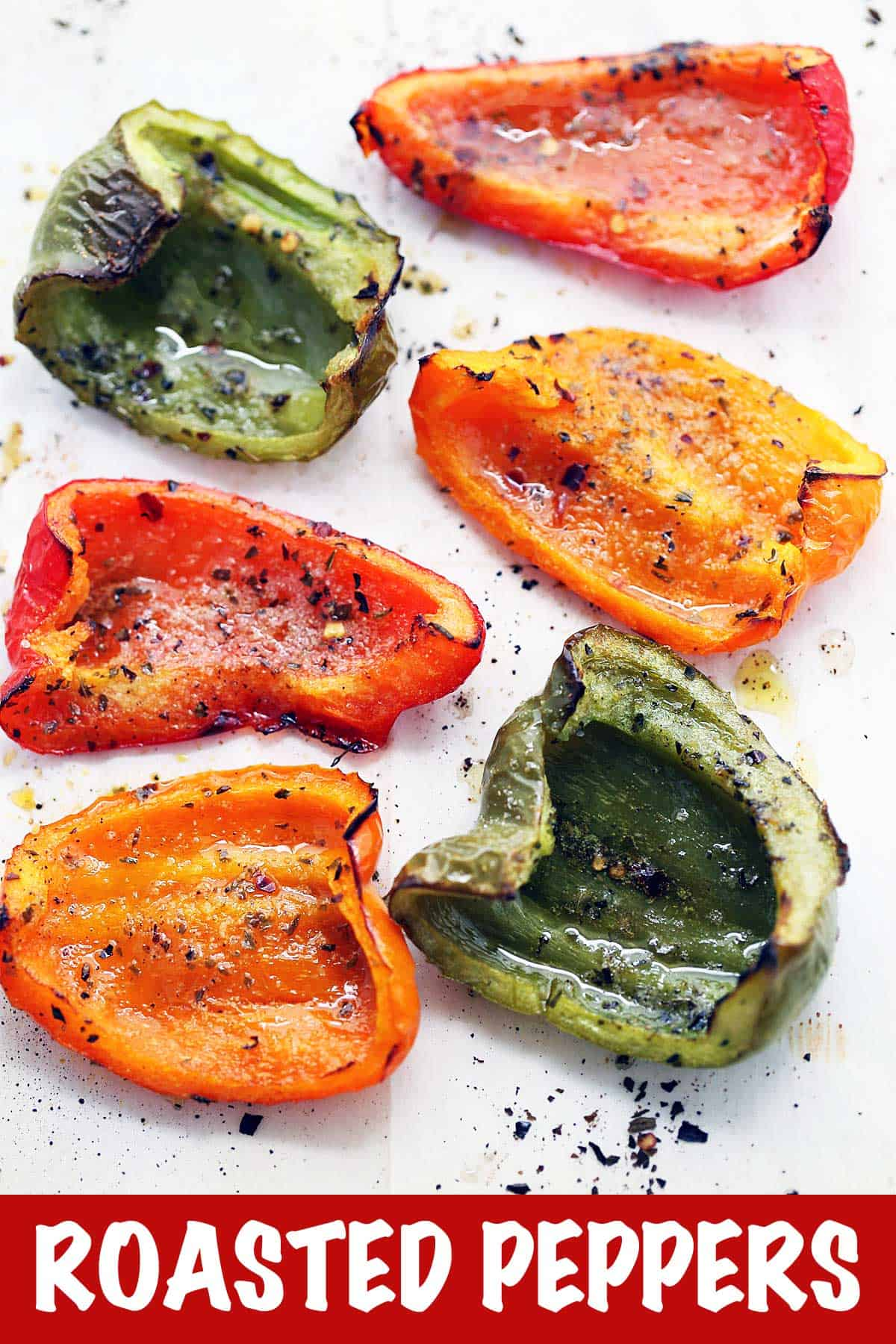 Roasted bell peppers served on a white plate.