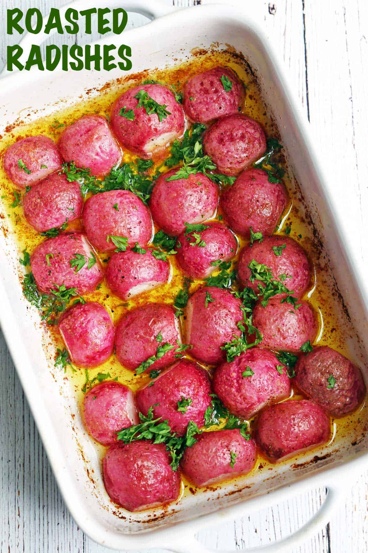 Roasted radishes served in a white baking dish.